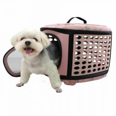 Pink dog carrier with flowers can also be used as a dog bed