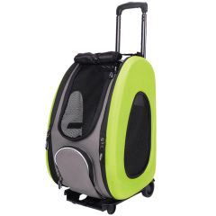 Green dog trolley as combination with dog bag, dog backpack and dog car transport box